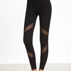 NEW WITH TAGS black skinny mesh paneled leggings
